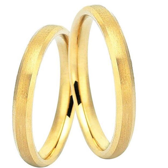 Χρυσές βέρες γάμου σε λιτές γραμμές